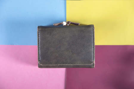green wallet on the color table background