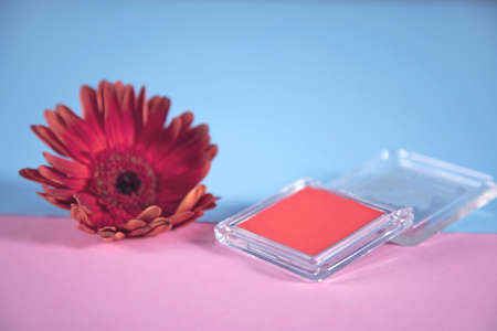 makeup powder and flower on the table