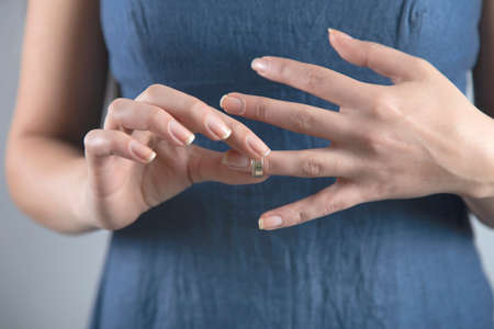 young woman remove the wedding ring