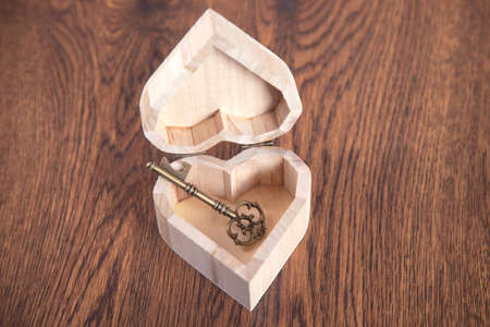 house key on wooden heart on the table