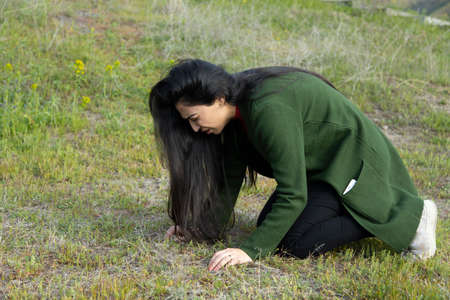 woman fell to the ground in nature background