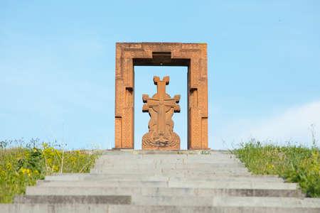 cross in mountain under blue sky background