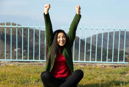 young happy woman in the mountain background