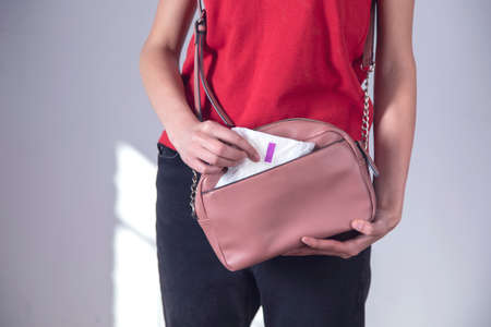 woman hand menstrual pad in the bag