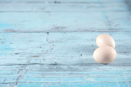 eggs on the blue wooden table background