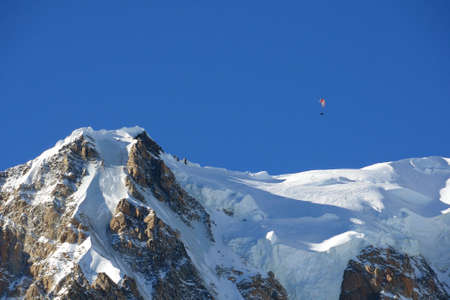 courmayeur: Paraglider over the summit of Mont Blanc massif, Italy