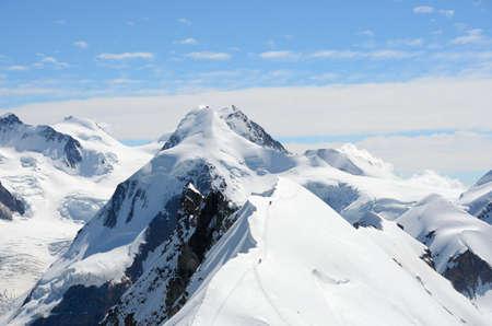 roped: View over the Alps from the Breithorn summit, Zermatt, Switzerland