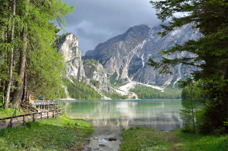 Braies lake in a cloudy day, Dolomites, Italy Stock Photo