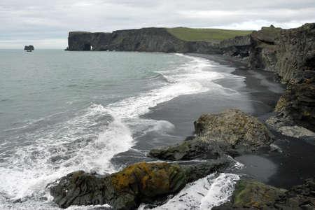 Ice rain in hail in Kirkjufjara black beach Iceland makes natural layers
