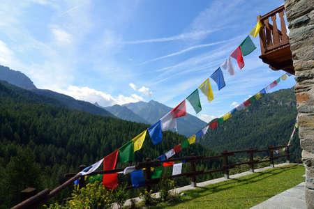 Colorful backlit Himalayan prayer flags, Valle dAosta, Italy