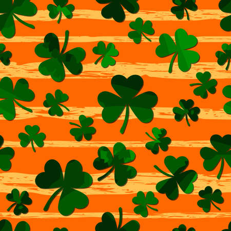 green motley shamrock on grunge gold stripes. vector seamless pattern. patrick repetitive background. St. Patricks Day. textile paint. fabric swatch. wrapping paper. modern stylish texture