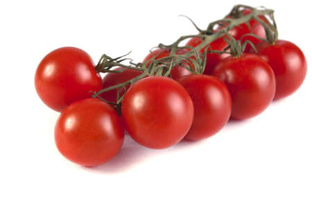 brush of ripe tomatoes on a white background