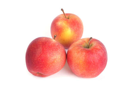 composition from three ripe apples on a white background