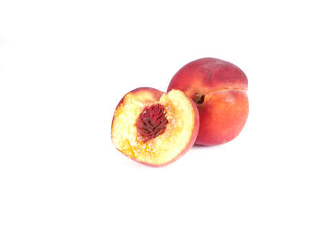 composition of ripe peaches on a white background