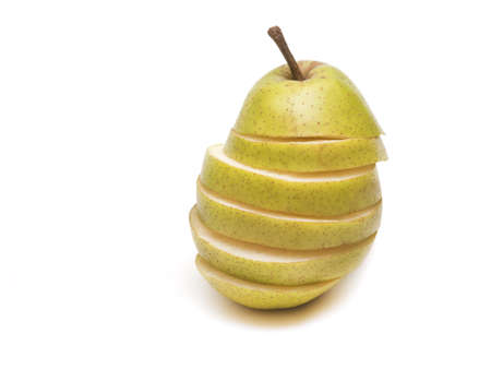 fruit composition. chopped green pear on white background Stock Photo