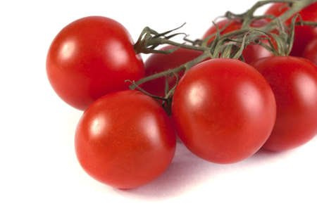 ripe red tomatoes on a white background Stock Photo