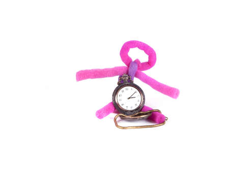 toy from foam rubber and a pocket watch on a white background