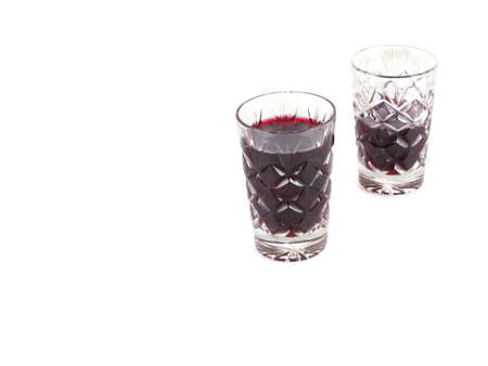 two crystal glasses with wine on a white background