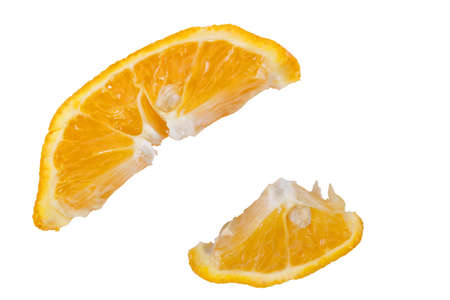 two ripe slices of orange on a white background