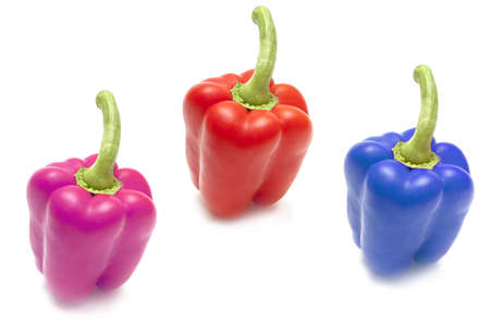 Vegetable composition of the three colored peppers on a white background