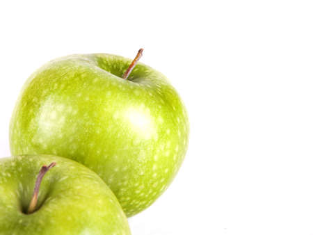 Fruit composition of two green apples on a white background 版權商用圖片