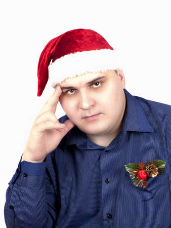 young man in a blue shirt and in a cap of Santa Claus on a white background photo