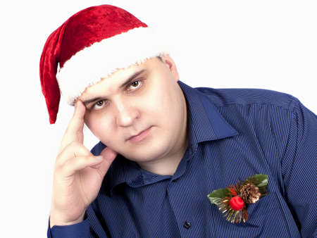 young man in a blue shirt and in a cap of Santa Claus on a white background