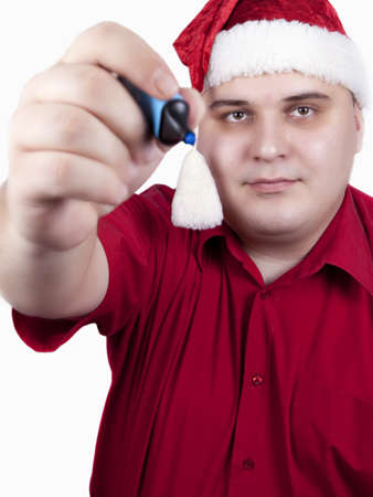 young man in a red shirt and hat of Santa Claus on a white background photo