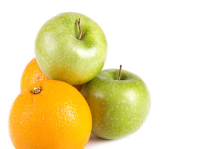 fruit composition, green apples and oranges on a white background