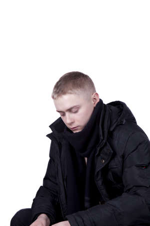 young man in a black jacket  on a white background Stock Photo