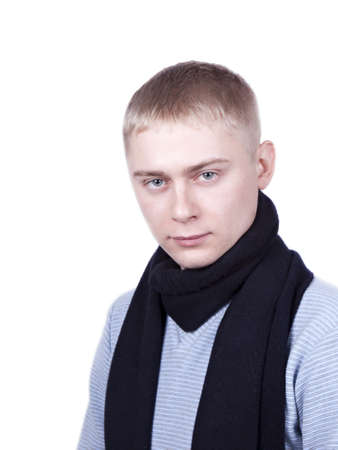 young man in a blue sweater and a black scarf on a white background