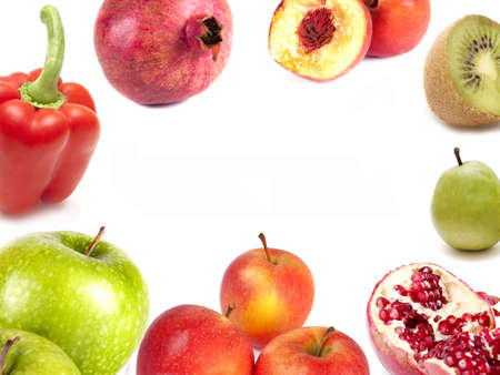 composition of apples, kiwi, pears, pomegranate and peach pepper on a white background