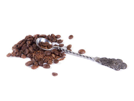 composition of coffee beans and a spoon on a white background
