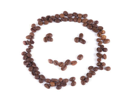 composition of coffee beans in the form of a smiley on a white background
