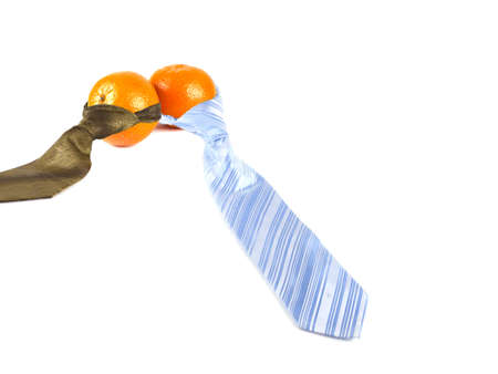 composition of two tangerines and two ties on white background Stock Photo