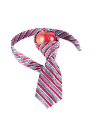 composition of red apple and a red tie on a white background