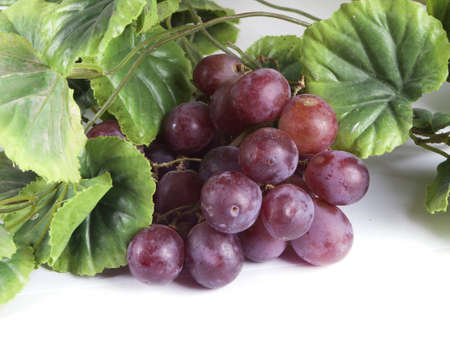 Blue ripe bunch of grapes on a white background