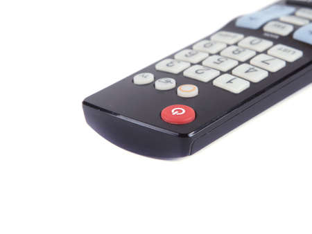 black TV remote on a white background