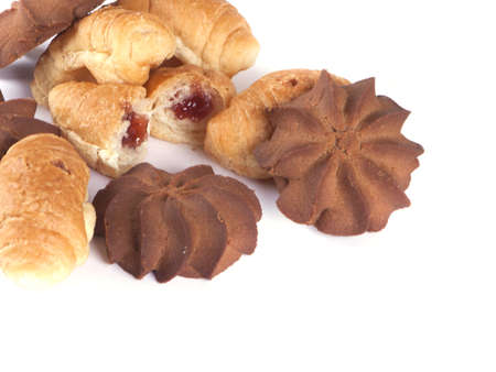 culinary composition from cookies and rolls on a white background