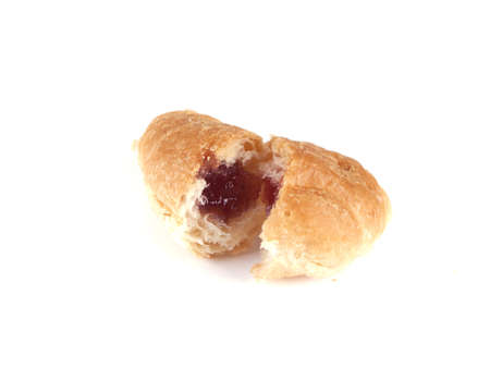 culinary composition of scones with jam on a white background