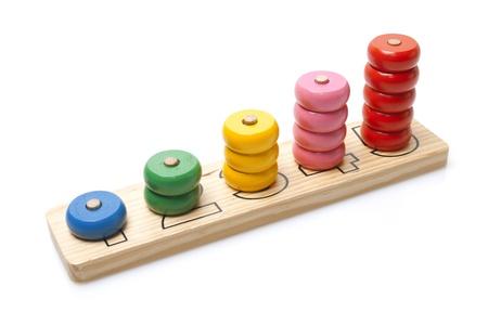 houten speelgoed op een witte achtergrond Stockfoto