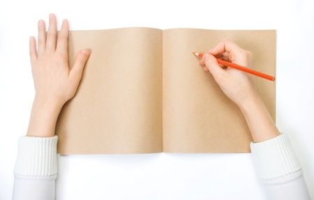 a child draws on the diary photo