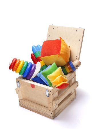 wooden box with many toys on white background