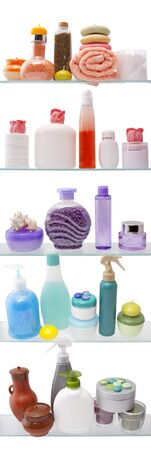 Shelf with cosmetics in a bathroom on the white background photo