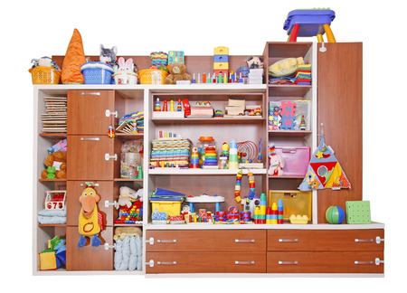 Shelf with many colored toys Imagens
