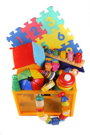 Box with very many toys Imagens