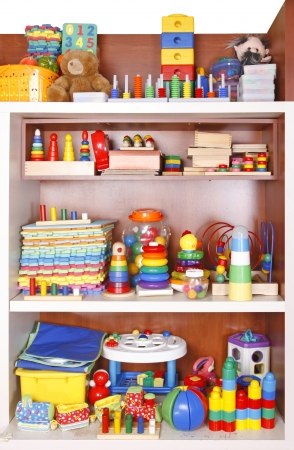 stuffed toy: Shelf with many colored toys Stock Photo