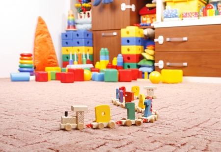 wooden train in room for children