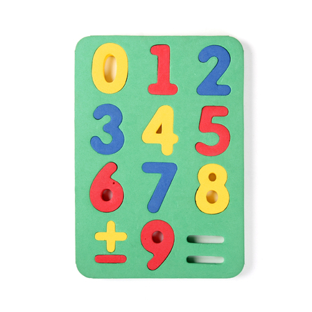 Numbers puzzle pieces on white background photo