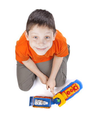 Top View Fisheye Shot of a Baby Boy Sitting on white background photo